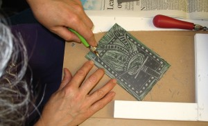 carving snowman in lino block