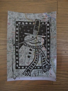 snowman lino cut printed on map