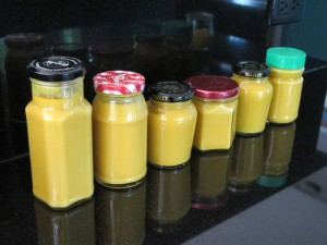 mustard jars lined up on the counter