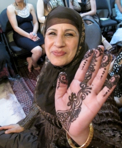 party guest showing her henna