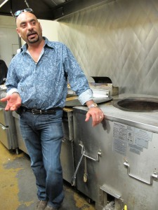chef next to tandoor oven