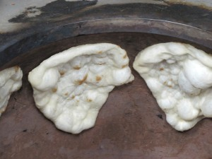 naan bread starting to brown in the oven