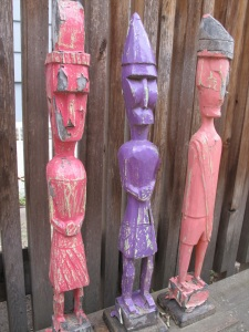 three wooden figures