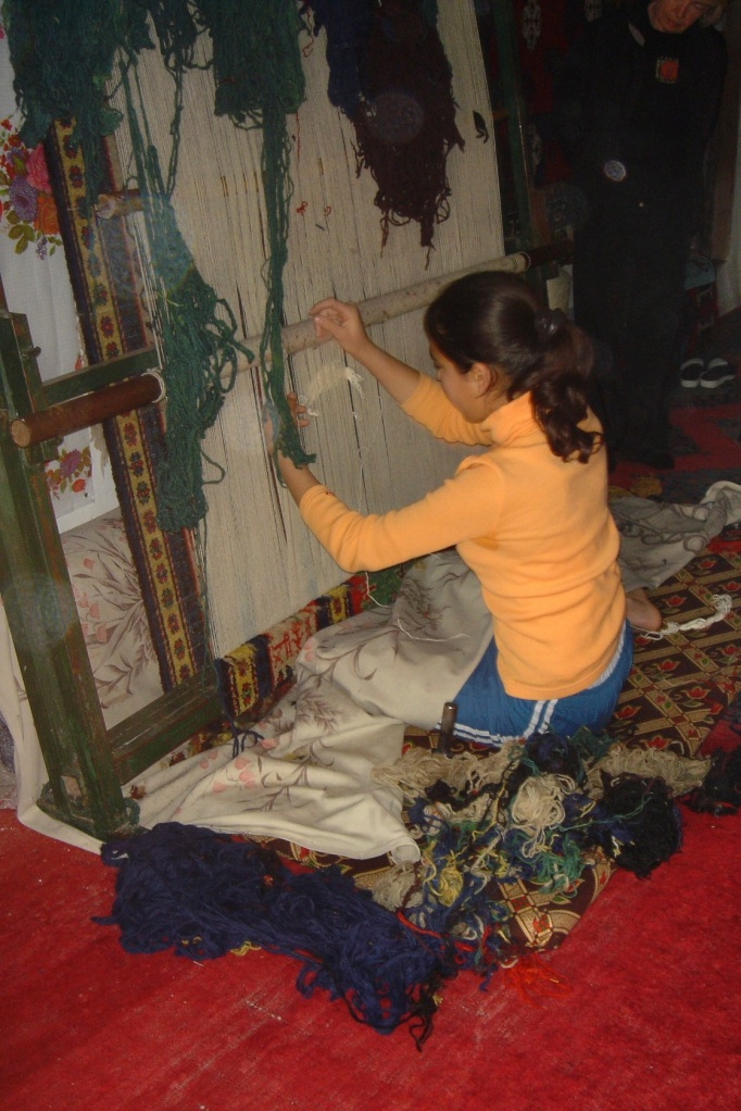 young girl weaving