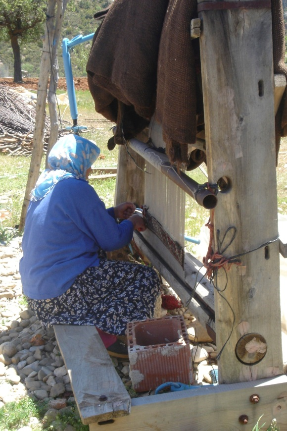 nomadic woman weaving
