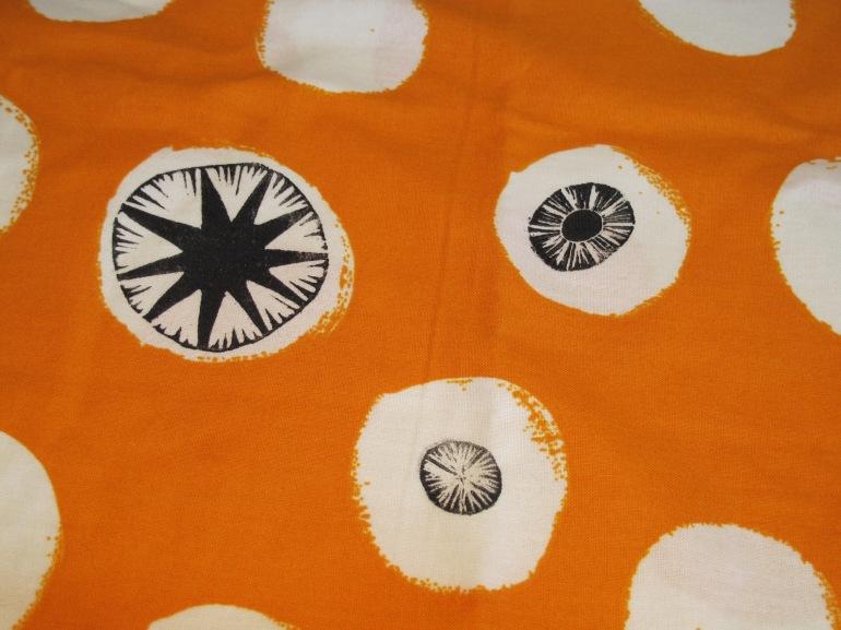 orange spotted apron detail