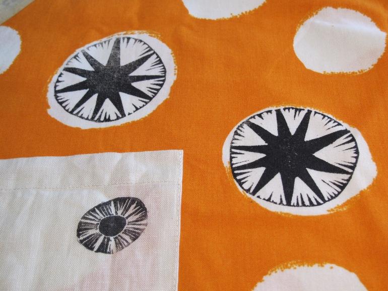 more details on orange apron