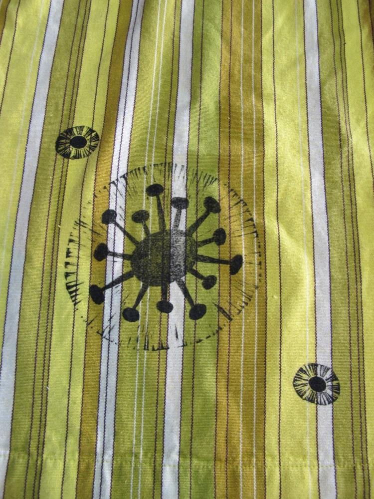 detail on green apron