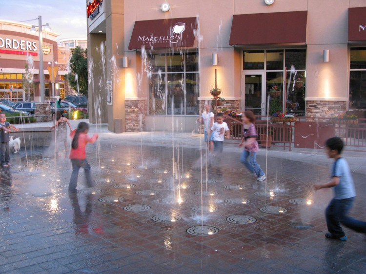 kids playing in fountain