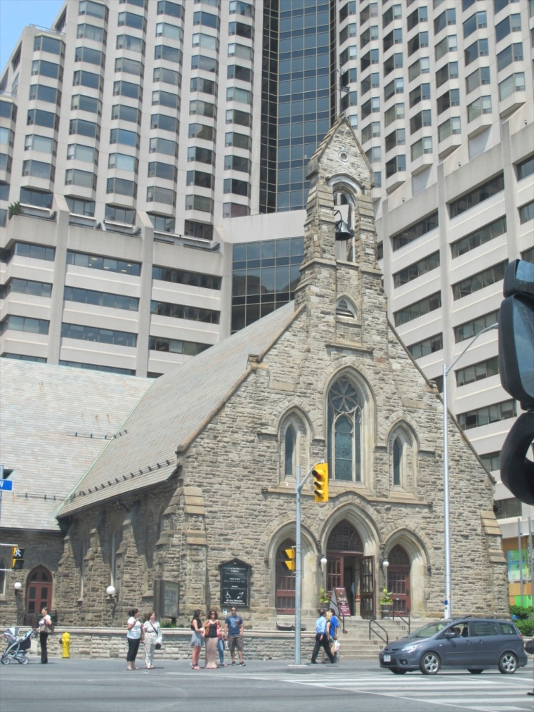 church surrounded by high-rises