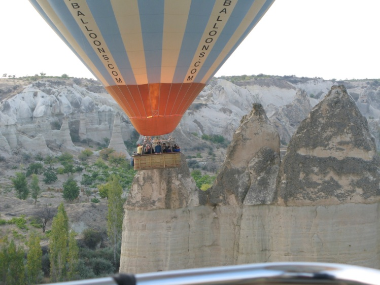 balloon merging with landscape