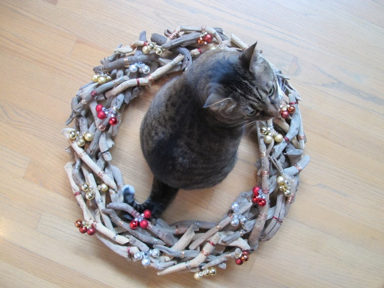 Kush sitting in wreath