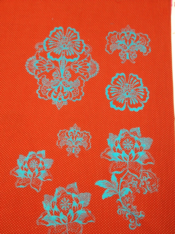 blue print on red fabric