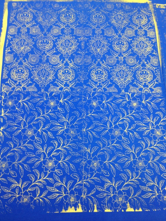 gold ink on blue fabric