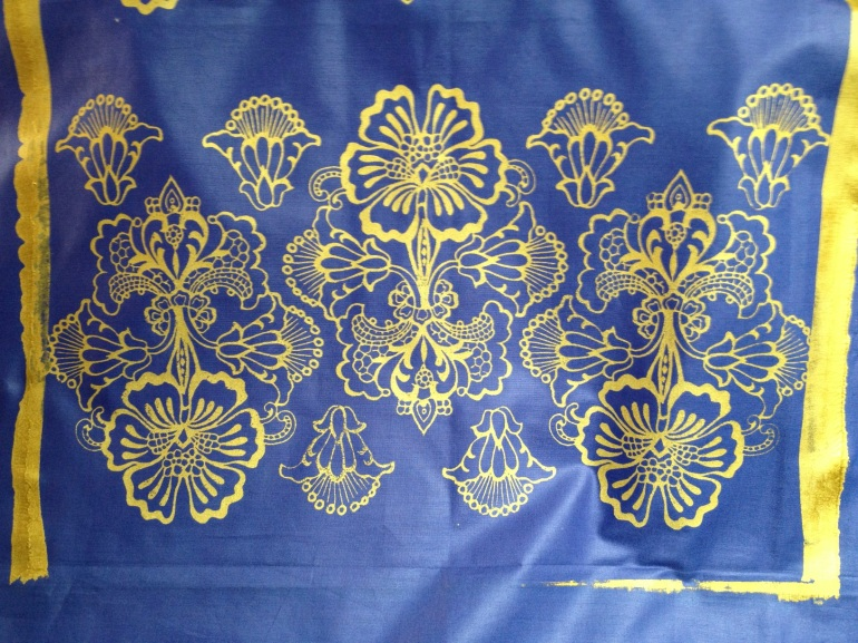 gold on blue sateen fabric