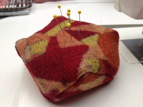 red and orange pincushion
