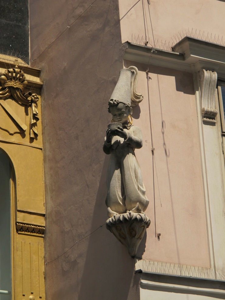 small sculpture on building
