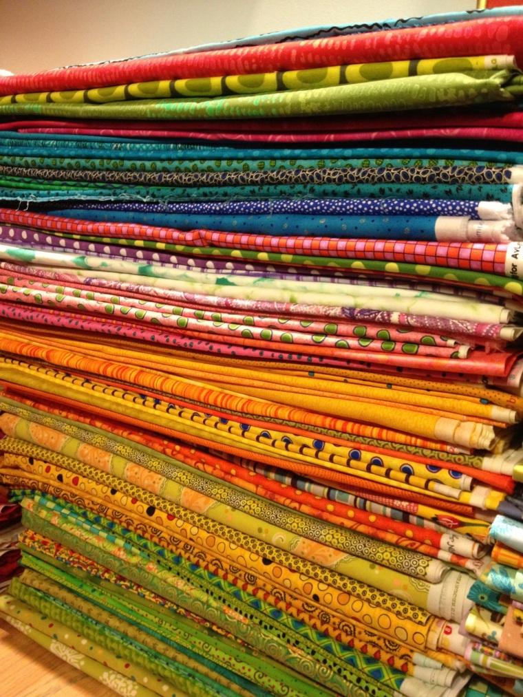 stack of quilt fabrics