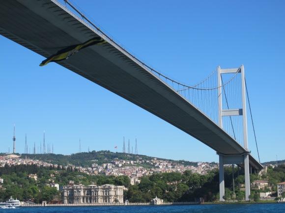 soccer flag blowing under a bridge