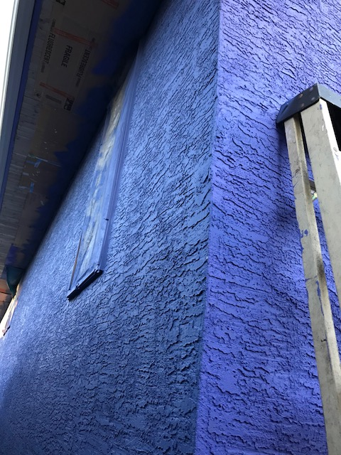 blue stucco house corner